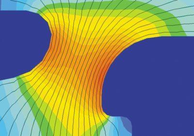 Распределение напряженности электрического поля между дифлектором и высоковольтным электродом (оранжевым цветом отмечена наиболее уязвимая область)